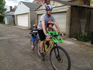 The men in my life out for a spin on their uber-bike.