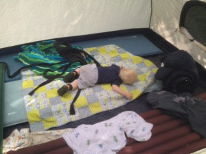 baby napping in a tent